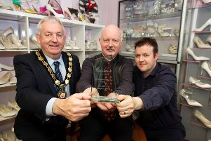 Cllr Sean McPeake  with Nigel and Scott Patterson from Pattersons Shoes and their Rainbow Club Irish Retailer of the Year award.