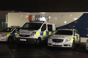 Police vehicles parked outside Craigavon A&E