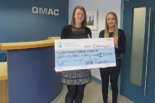 Sonia Kelly of QMAC Construction is pictured recently presenting the cheque to Anne Mac Oscar of Southern Area Hospice.