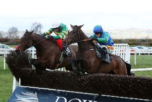 Press Eye - Belfast - Northern Ireland - 16th March 2019 - ''Race 4 4:15 NORTH DOWN MARQUEES RATED NOVICE CHASE'Biddy The Boss, right, ridden by Sean Flanagan beats Crossed My Mind, ridden by Niall Madden in the fourth race  at the St Patricks Day race meeting at Down Royal Racecourse.''Photo by Kelvin Boyes / Press Eye