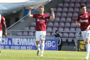 COOL FINISH: Dean Bowditch's excellent volley gave the Cobblers a first-half lead on Friday. Pictures: Pete Norton