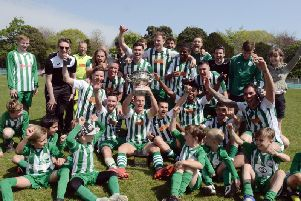 Chi City and friends celebrate with the league trophy / Picture by Kate Shemilt