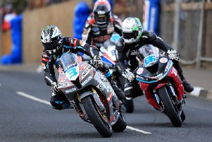 Michael Dunlop leads Adam McLean and Derek Sheils in the Supersport race at the Cookstown 100 in 2018.