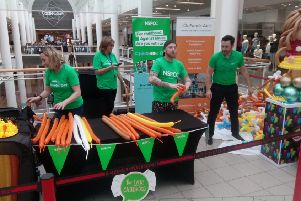 Ryan Tracey attempts to break the balloon modelling World Record, with a bit of assistance from the team from NSPCC NI.