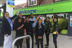 Councillor Carson Albury (left) with Subu Nanthakumar (centre, back row) and staff from the Co-op