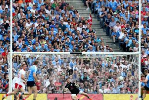 Dublin's Paul Mannion scores his side's crucial first half penalty past goalkeeper Niall Morgan.