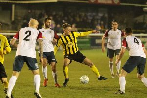Connor Taylor works hard to hold on to possession for Leamington. Pictures: Tim Nunan