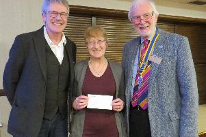 Stuart and Jackie Potter with David Smith, Rotary president