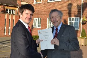 Nigel Robinson receives his DofE Gold Award from headmaster Dr Deneal Smith.