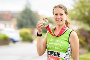 Georgie Acton with her London Marathon medal.