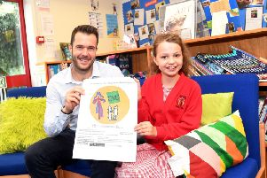 Pictured with Beatrice is her teacher John Marsh.