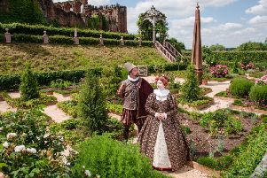 Queen Elizabeth I and Robert Dudley on the grounds of the Elizabethan Gardens