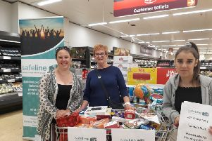 Volunteers collecting for the Safeline tombola in Sainsbury's in Saltisford. Photo supplied.