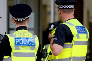 Police hunt man who robbed pair at knife-point in early hours of Tuesday
