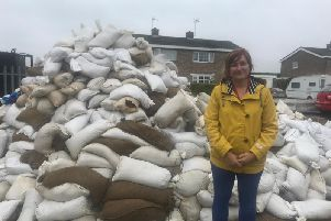 Michelle Howard, ELDC assistant director, people, by the pile of contaminated sandbags which need to be tested before disposal.