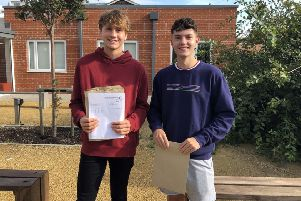 Seaford Head School students Harvey and Dan with their results