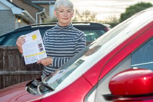 Jacky Merrison with her parking penalty notice. Picture: John Aron.