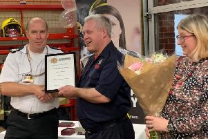 Kenilworth Firefighter Malcolm Gunter receiving his certificate of service