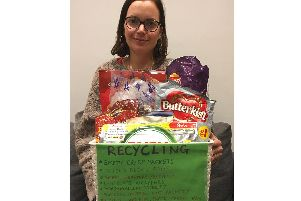 Suzie Sharp with a box of plastic recycling. Photo submitted.