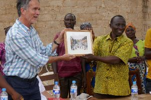 Kenilworth Town Cllr James Kennedy presenting the Karen Pittaway print to Village Chairman Owden Mwakanema