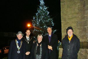 Standing at the Whitnash Tree of Light outside St Margaret's church are president of the Rotary Club of Royal Leamington Spa Colin Robertson,  'Mayor of Whitnash Cllr Robert Margrave, Community Fundraiser of The Myton Hospices Anita Burrows, Vicar of St Margarets Whitnash the Rev Richard Suffern and Vice President of  the Rotary club of Royal Leamington Spa Michael Heath.