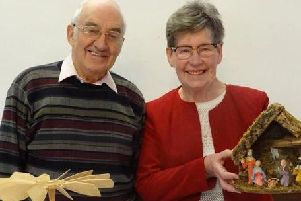 John and Marjorie Carrier with some of their nativity sets
