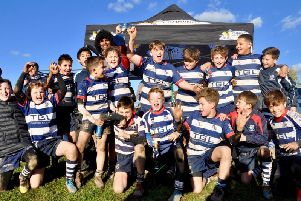 Wasps Ashley Johnson (back row) with Banbury RUFCs under-12s who triumphed at the Wasps Land Rover Premiership Rugby Cup tournament, which was held at Old Leamingtonians RFC.