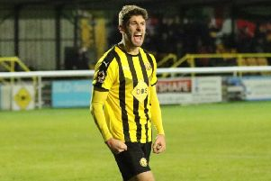 Goerge Carline celebrates notching Brakes' third at home to Darlington. Picture: Tim Nunan
