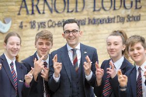 Arnold Lodge headteacher David Preston and pupils Olly Perkins, George Maddy, Maddy Whitehouse and Bethany Winchester, are all crossing their fingers ahead of Friday evenings TES awards at the Grosvenor House Hotel, in London