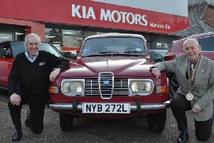 Colin Robertson (right), president of the Rotary Club of Royal Leamington, with Kia Warwick managing director David Derbyshire and his classic 1975 Saab 95