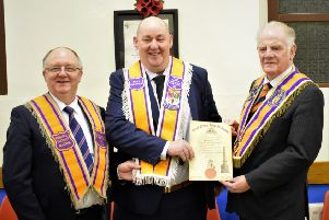 Brother Derrick Stewart (centre) receiving his Past Masters Certificate and Collarette from Worshipful Brother Gordon McCrory, Worship District Master, Ballymena District L.O.L. No.8 (left) and Right Worshipful Brother Robin Mathews, Right Worshipful County Grand Master, County Antrim Grand Orange Lodge
