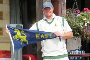 Skipper Carl Wilson with the Eastern Division championship pennant.
