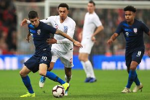 Christian Pulisic (left) on show for USA against England. Pic by PA.