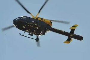 The police helicopter was seen circling the skies above Crawley