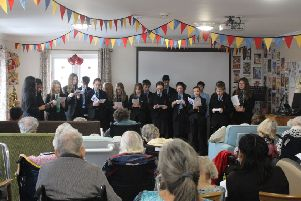 The Chatsmore High School choir performing at Haviland House, Guild Care's specialist dementia care home