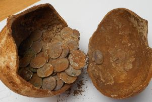 The coins in vessel they were discovered in. Photo by Warwickshire County Council.
