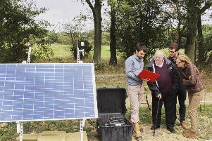 MEP Keith Taylor with seismologist Dr Stephen Hicks and local oil campaigner Vicki Elcoate with an earthquake monitor installed in Surrey  in 2018 SUS-190218-120526001