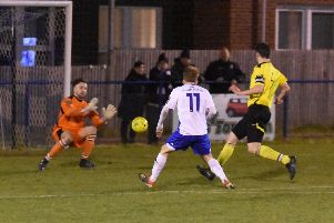 Alex Laing sees his shot saved.