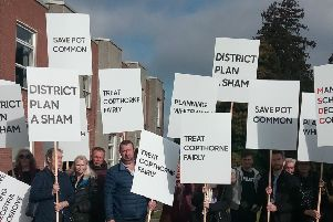 Residents protesting against the application before the committee meeting