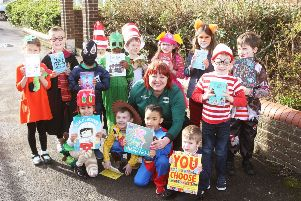 DM1930554a.jpg. World Book Day at Lyndhurst Infant School, Worthing. Nikki Storer, community champion and children with books for their school library, donated by Morrisons Worthing. Photo by Derek Martin Photography