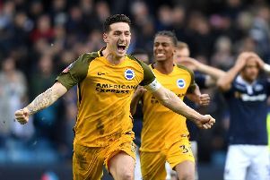 Lewis Dunk celebrates Brighton's win at Millwall. Picture by Mike Hewitt / Getty Images
