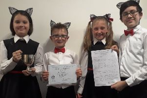 The Minims, Harry Cole, 12, Florence Cole, ten, Yolanda Thomas-Negro, ten, and Ewan Thomas-Negro, eight, with their trophy