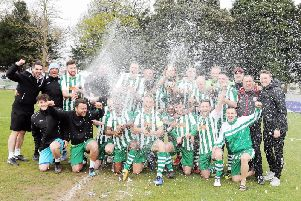 The champagne corks are off as Chi City players and staff show their jubilation at landing the SCFL title / Picture by Kate Shemilt
