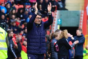 Mick Harford applauds the huge travelling support at Chartlon (Picture: Liam Smith)