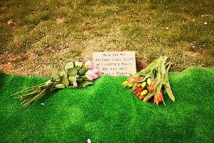The grave stone laid at the grave of the unknown woman found at Birling Gap