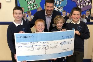Southway Junior School council members receive a �1,000 donation from South East Water communications officer Chris Laming.