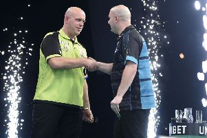 Rob Cross (right) shakes hands with Michael van Gerwen after their match on night three of the Unibet Premier League in Dublin. Picture courtesy Michael Cooper/PDC