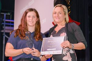 After last years successes Kimberley Woods was crowned Rugbys Sportswoman of the Year 2018 and is pictured receiving her award from former England rugby international Vicky Macqueen at the ceremony in February