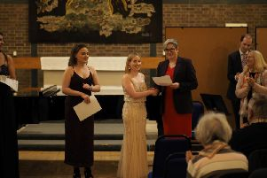The completion was won by Bryony Morrison (voice), seen receiving her prize of 600 from Professor Catherine Harper, Deputy Vice Chancellor.