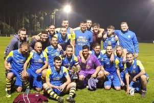 Rustington celebrate with the trophy